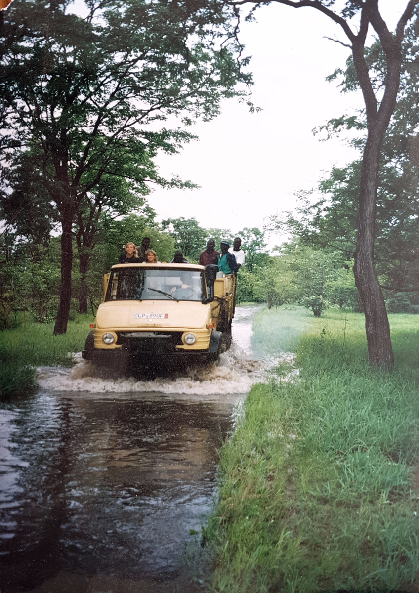 A truck driving on the flooded roads of Tafika Camp after the heavy rain in 1996