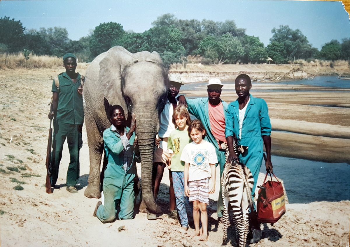 Staff members of Remote Africa Safaris with the Coppinger children, their elephant and their zebra