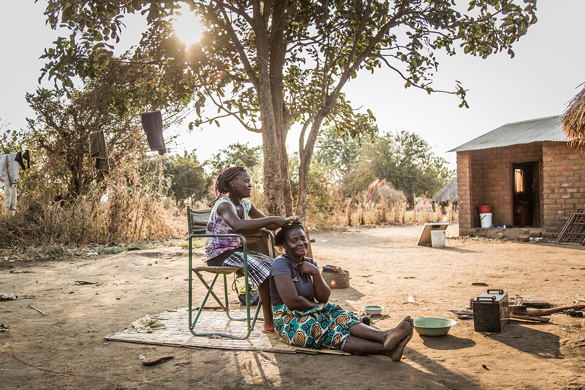 A local lady gets her her hair braided in the Mkasanga village in Zambia