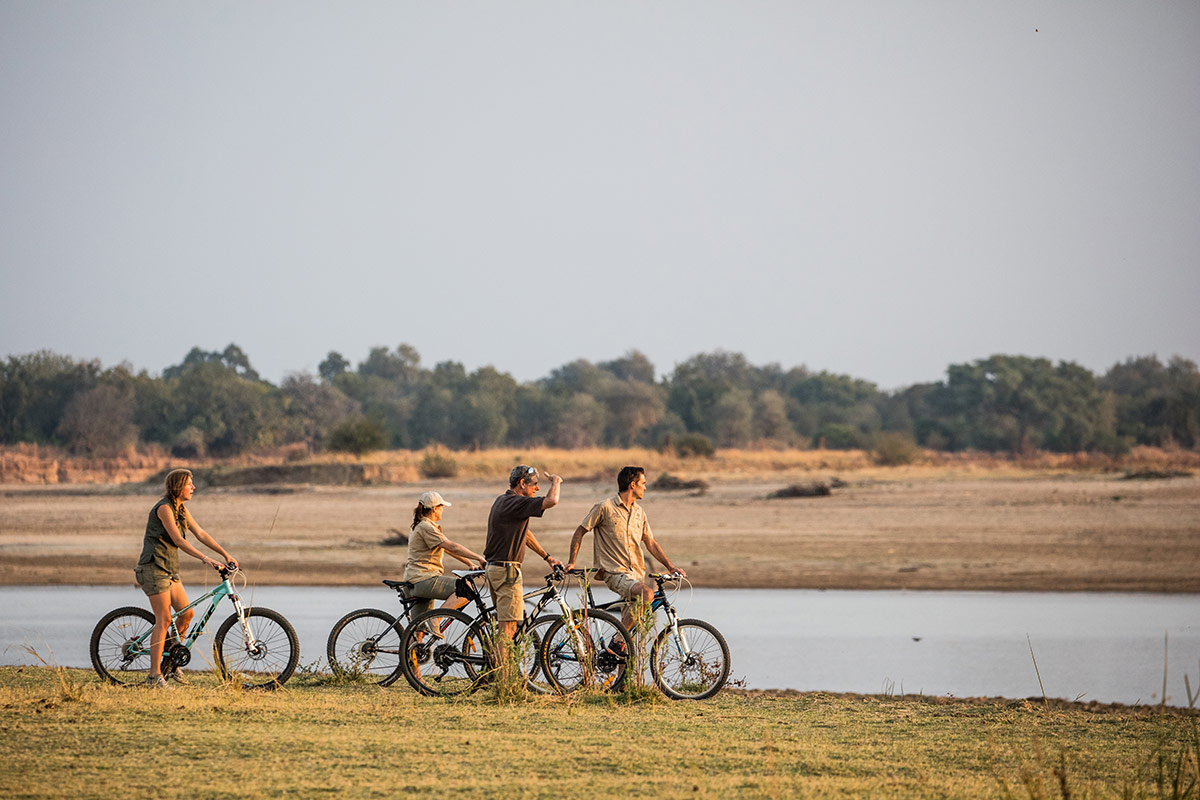 Remote Africa Safaris guests on a cycling safari takes a breather on the bank of the Luangwa River