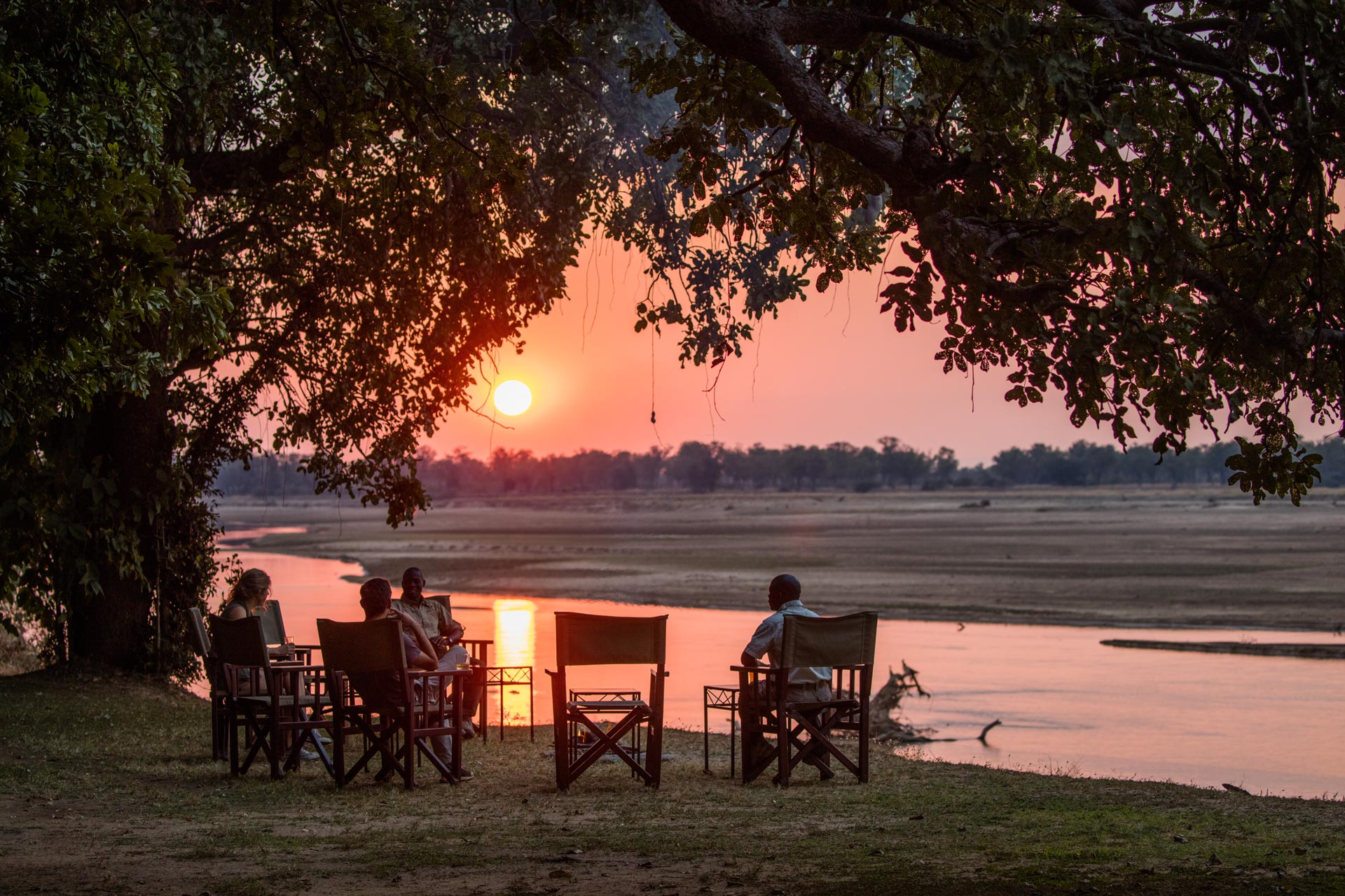 Enjoying sundowners on the east bank of the Luangwa River at Tafika Camp in Zambia
