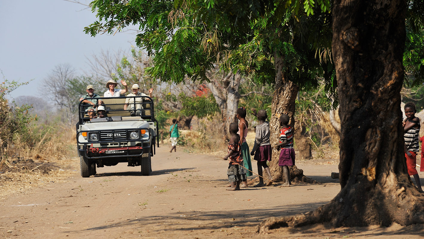 Remote Africa Safaris driving guests into the Mkasanga village in Zambia