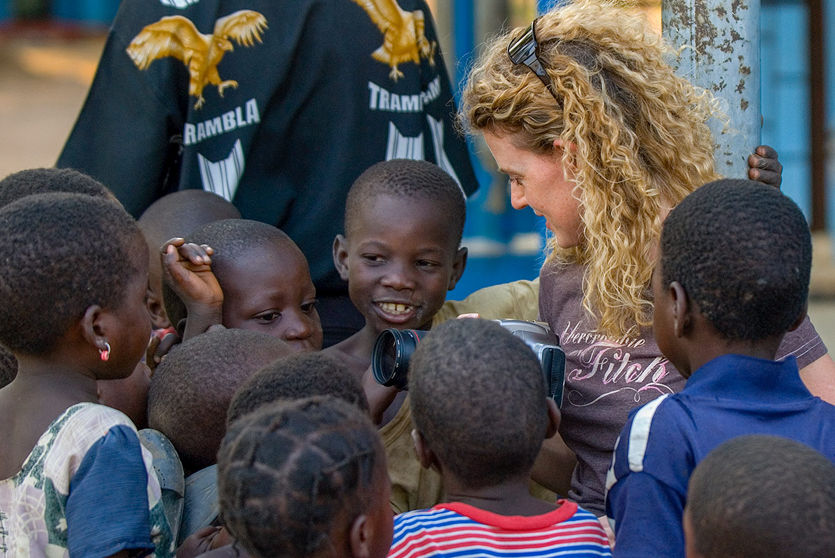 A guest of Remote Africa Safaris entertaining the local childern from the Mkasanga village in Zambia with her camera