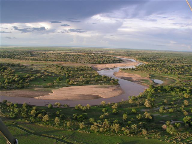 An arial view of the Luangwa Valley as rain clouds roll in over the horizon