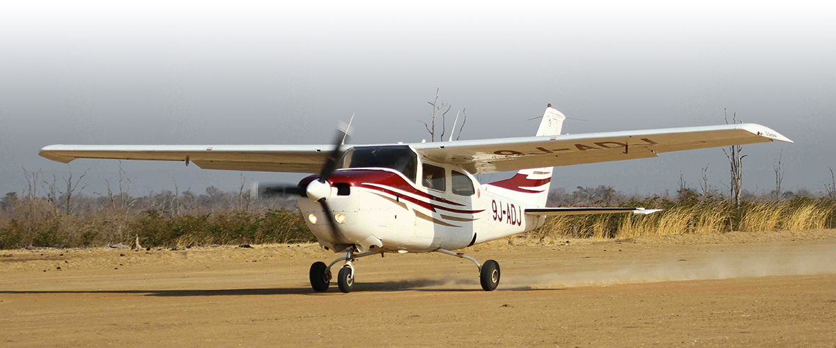 Remote Africa's in-house Cessna 210 taking off from Mwanya (Lukuzi) airstrip close to Tafika Camp and the Chikoko Trails camps in the South Park