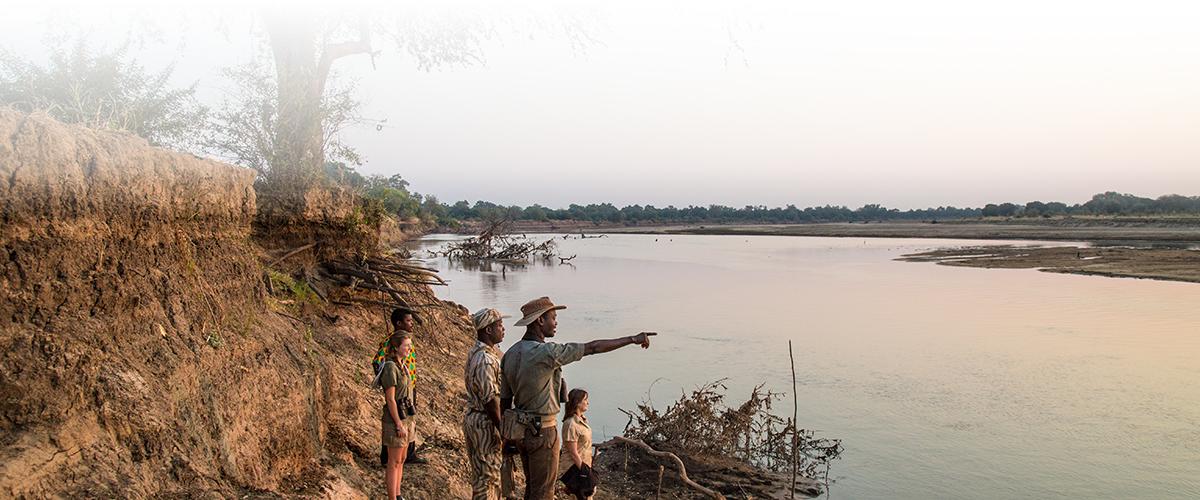 Guests of Remote Africa Safaris Chikoko Tree Camp enjoying a walking safari on the banks of the Luangwa River