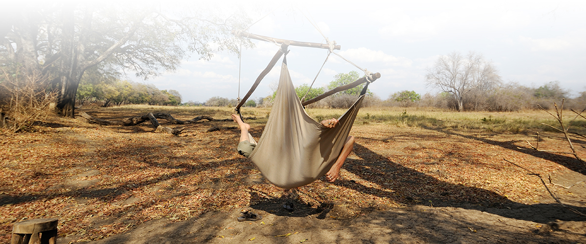 A guest of Remote Africa Safaris Crocodile Camp enjoying a late afternoon nap in a hammock.