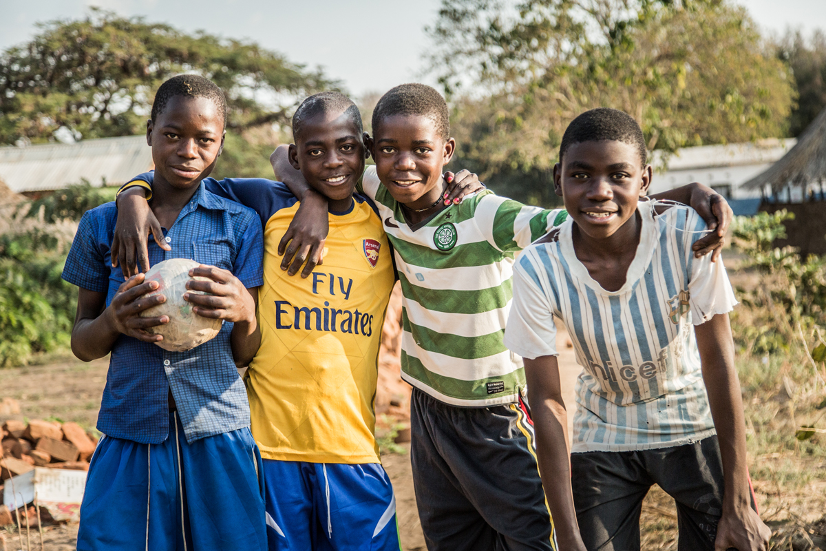 Four aspiring footballers from a local village in the Luangwa Valley during the Football for Wildlife league, started by Remote Africa Safaris in 2015