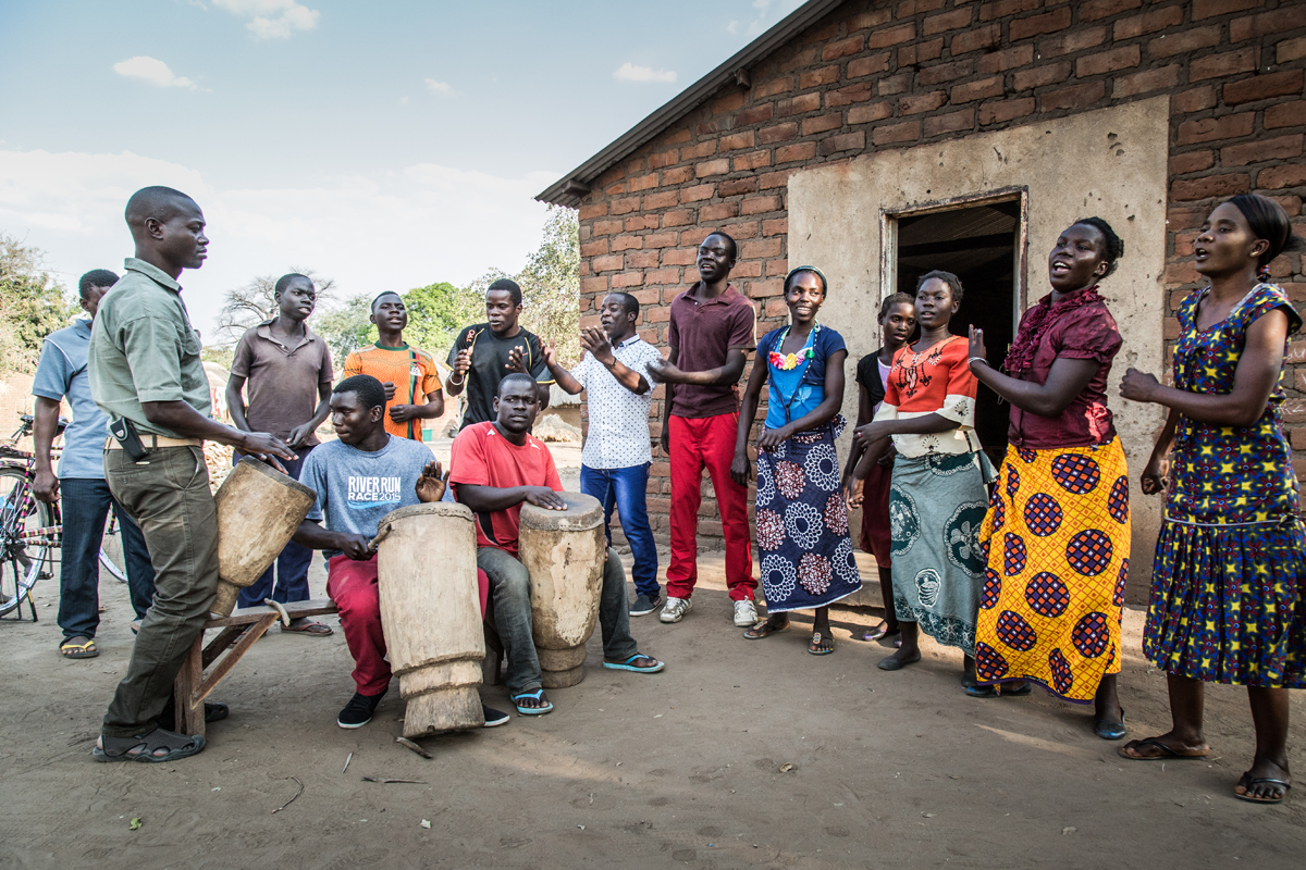 The locals from the Mkasanga village in Zambia entertaining the guests of Remote Africa Safaris with song and dance.