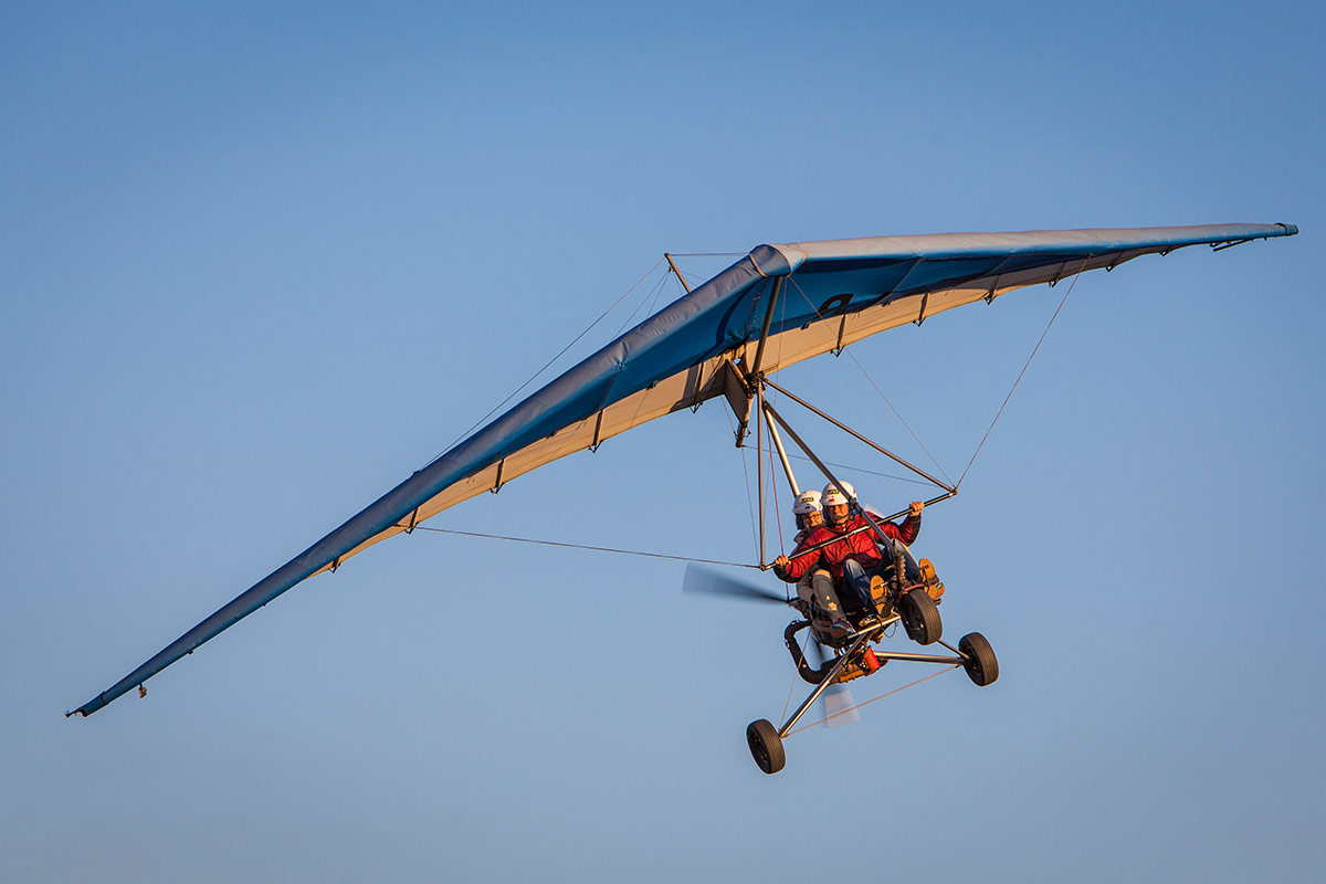 Remote Africa Safaris Microlight banking right on a clear cloudless day in the Luangwa Valley, Zambia