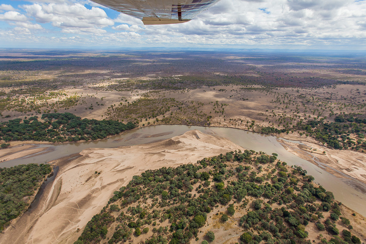 An arial view of the Luangwa Valley from under the wing of Remote Africa's in-house Cessna 210