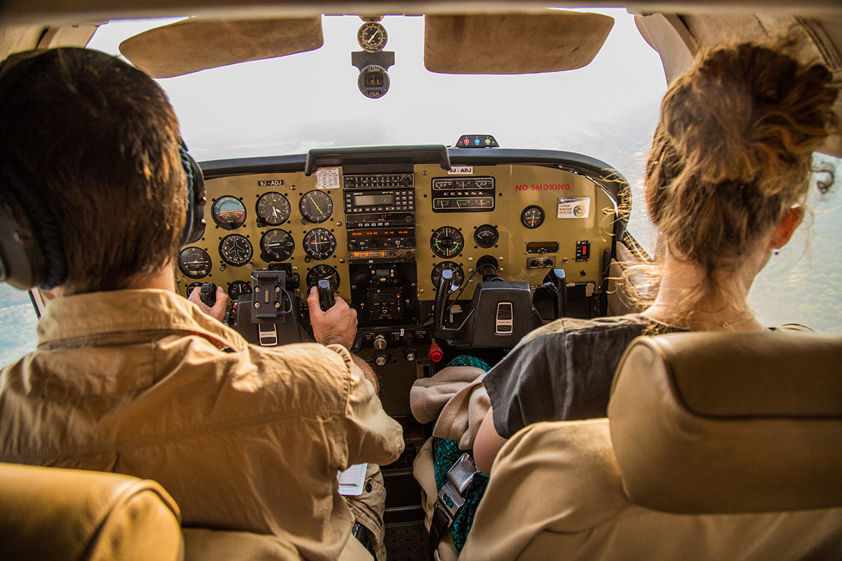 A view of the Remote Africa Safaris Cessna 210's cockpit and flight controls