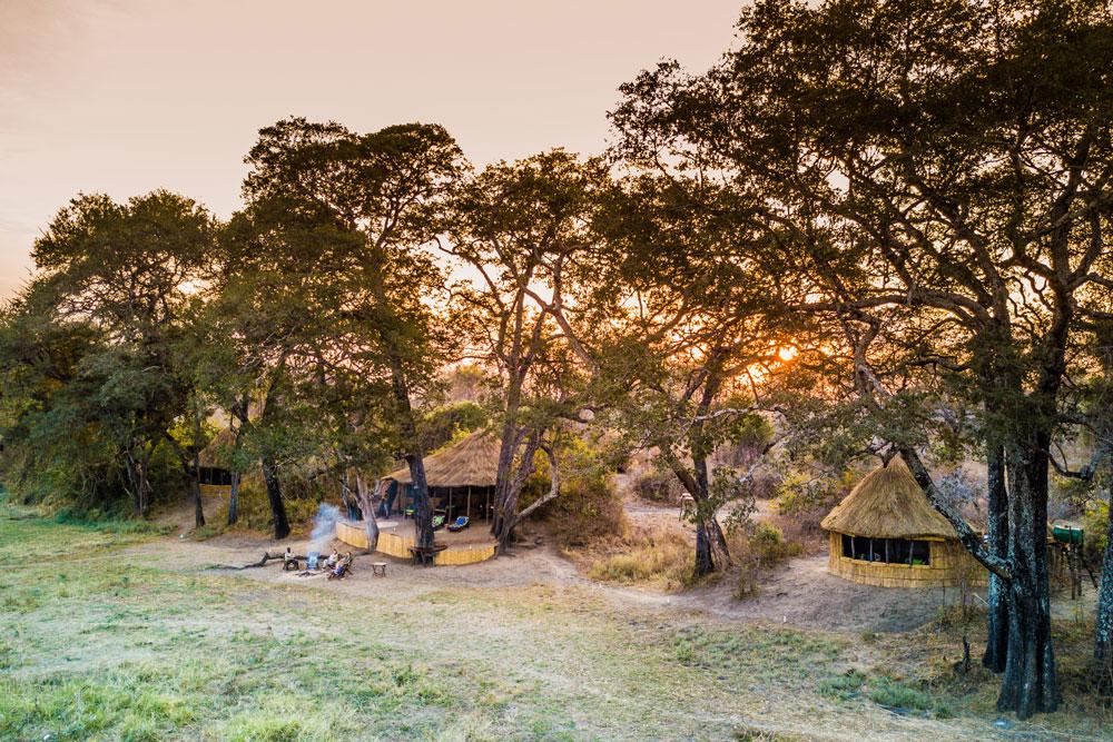 Sun setting behind Crocodile Camp in South Luangwa National Park, Zambia