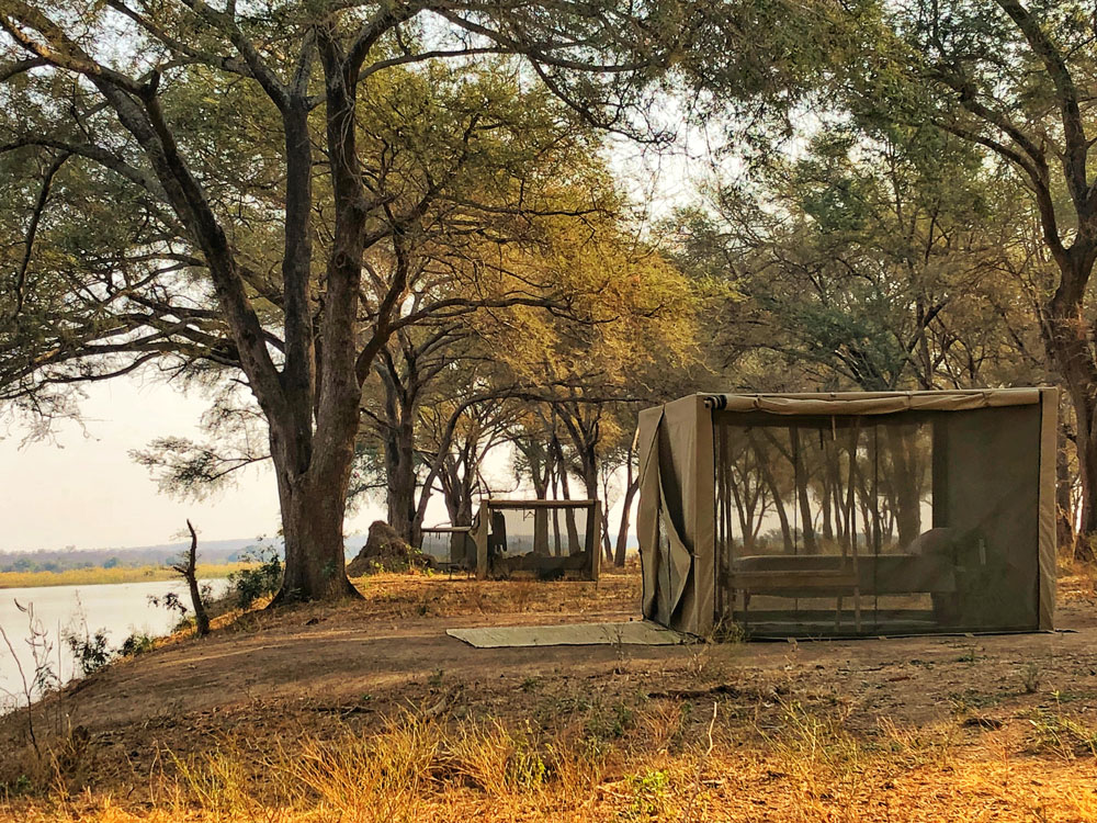 https://www.remoteafrica.com/wp-content/uploads/2019/10/SML-Tent-View-6-at-Kutali-Island-Camp-.jpg
